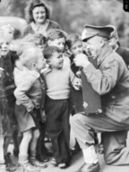 Private Jack Martin entertains the kids, 1943