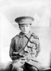 A child dressed in uniform, 1915