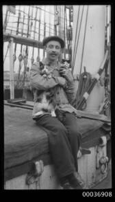 Seaman with a cat and kitten, c 1910
