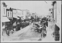Civil War Veterans, Fourth of July or Decoration Day, Ortonville, Minnesota. On review in center of town, ca. 1880.