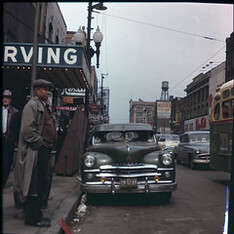 Halsted Street in Chicago looking north with the Irving Theater on the left (west) side of the street. 1956