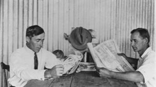 Cane farmers reading newspapers